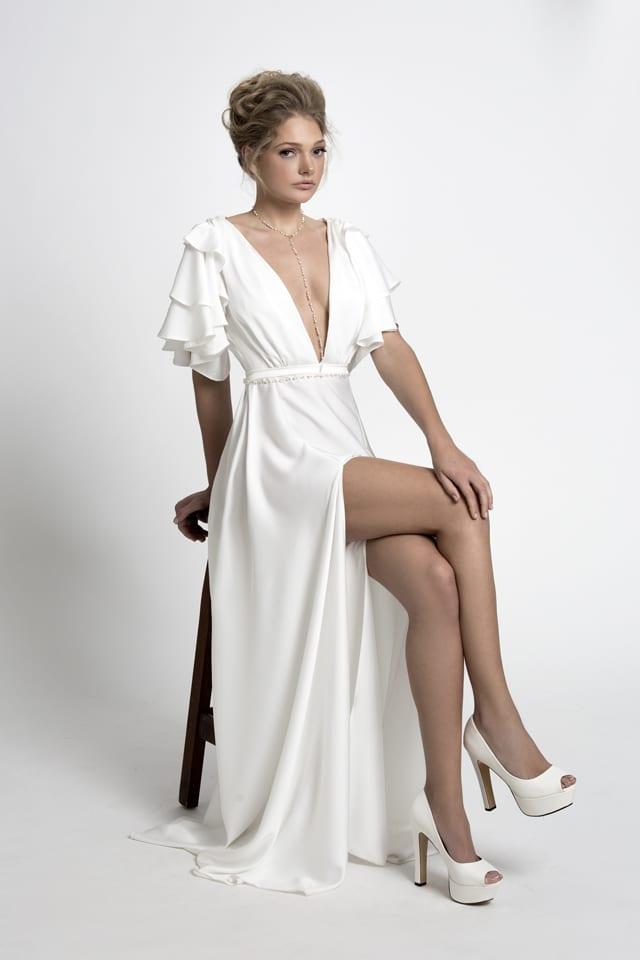 בצילום: שמלת כלה של ירדן מרציאנו. צילום: עמיר צוק - 1