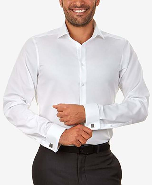 Craft a sleek, modern appearance with the slim cut and French cuffs of this comfortable Calvin Klein STEEL performance dress shirt_